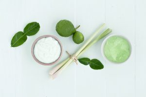 asian homemade fresh herbs scrubs and skin care on wood background